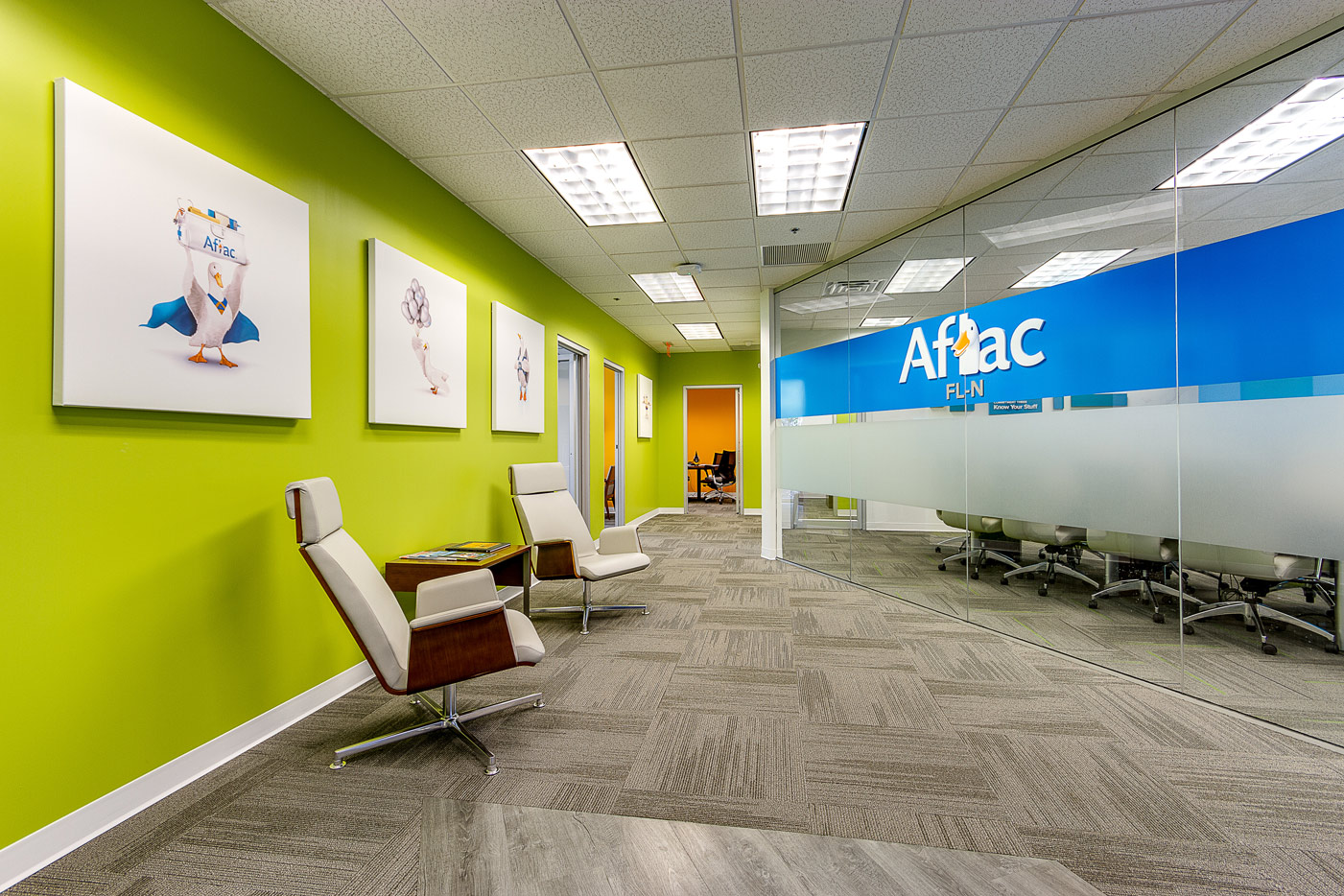 Aflac entryway with chair and logo