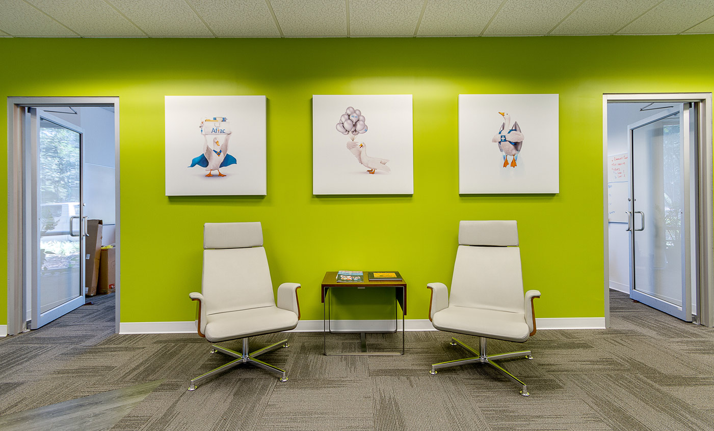 Aflac seating area with three pictures