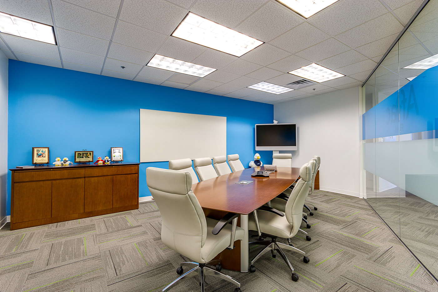 Aflac conference room with table and tv screen