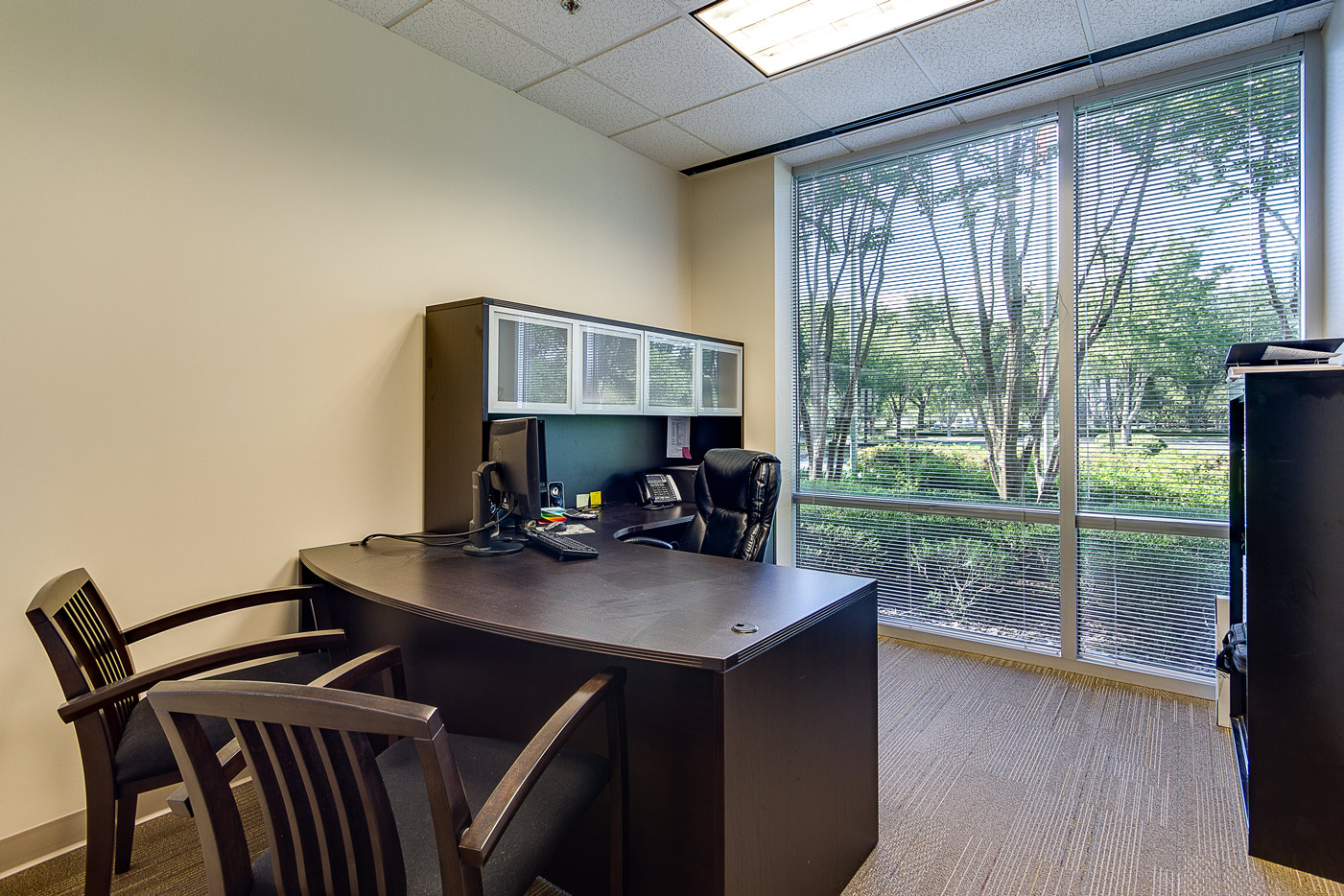 office with desk and large window