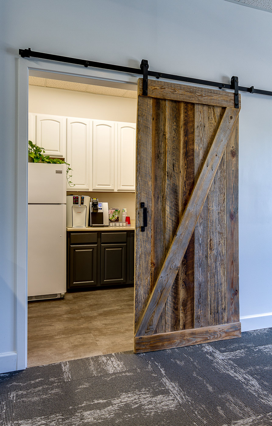 barn door into employee lounge