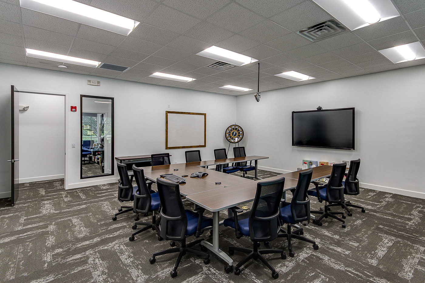 meeting room with u-shaped desk and chairs